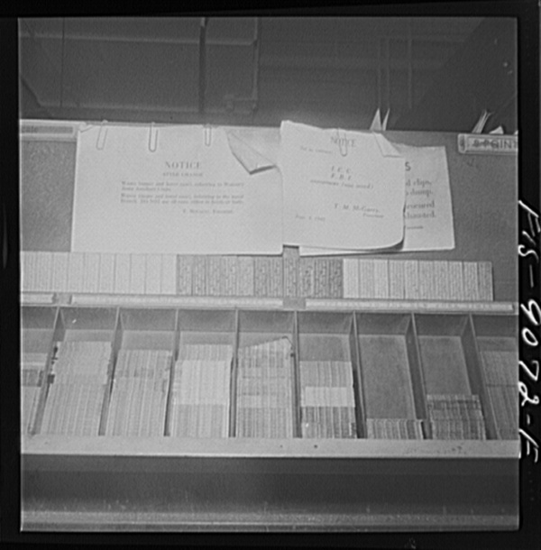 New York, New York. Composing room of the New York Times newspaper. Notices for type style changes in words such as WAAC (Women's Army Auxiliary Corp) and FBI (Federal Bureau of Investigation)