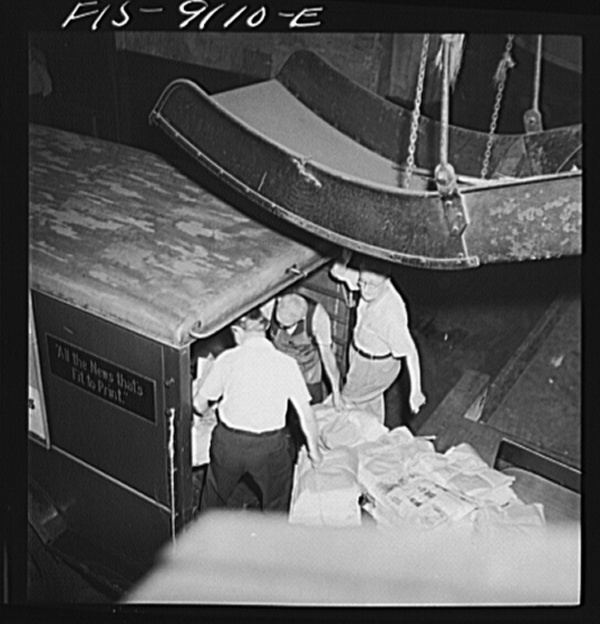 New York, New York. New York Times newspapers being loaded on trucks from mailroom
