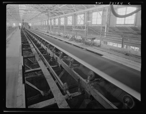 A conveyor belt which carried fine copper ore and discharges it into bins at one of the concentrators of the Utah Copper Company at Magna and Arthur in Utah