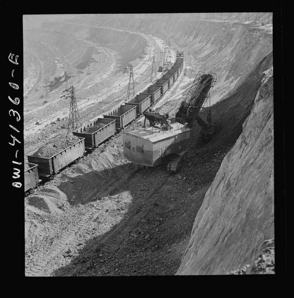 Bingham Canyon, Utah. Loading ore into car at an open-pit of the Utah Copper Company