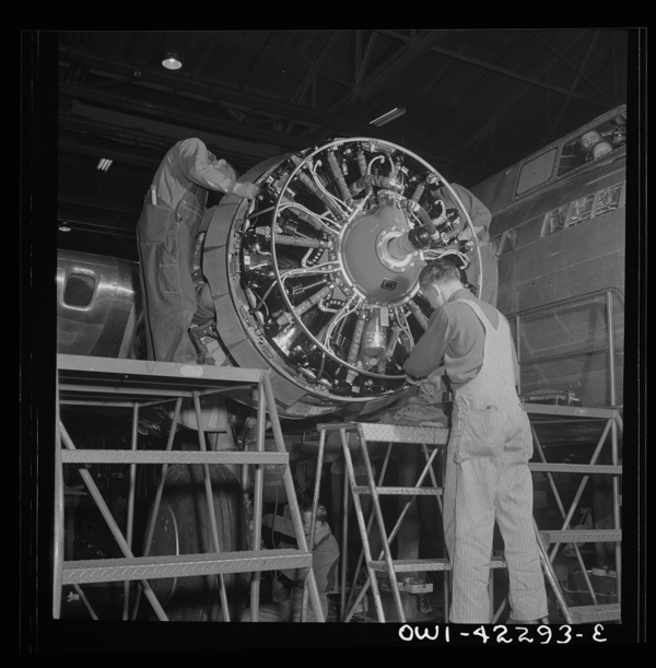 Seattle, Washington. Boeing aircraft plant. Production of B-17F (Flying Fortress) bombing planes. Workers assembling a motor for a B-17F (Flying Fortress) bombers