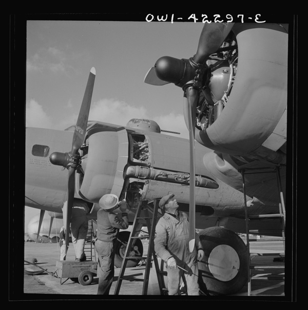 Seattle, Washington. Boeing aircraft plant. Production of B-17F (Flying Fortress) bombing planes. Lubricating and servicing a new B-17F (Flying Fortress) bombers