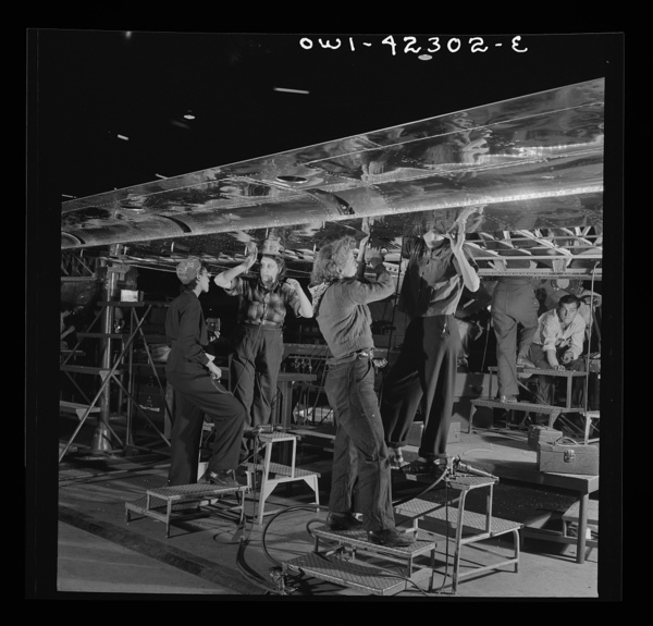 Seattle, Washington. Boeing aircraft plant. Production of B-17F (Flying Fortress) bombing planes. A crew working on the assembly of a wing