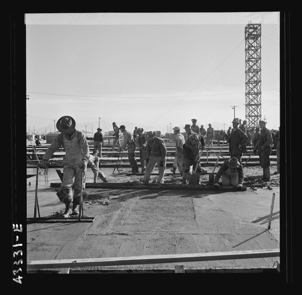 Columbia Steel Company at Geneva, Utah. Steel and concrete go into place rapidly as a new steel mill takes form. The new plant will make important additions to the vast amount of steel needed for the war effort