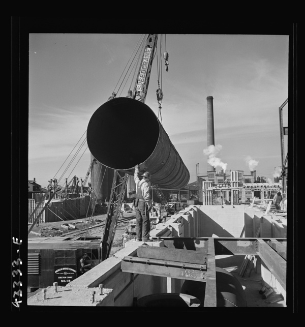 Columbia Steel Company at Geneva, Utah. Setting a pipe with a derrick during the construction of a new steel mill which will make important additions to the vast amount of steel needed for the war effort