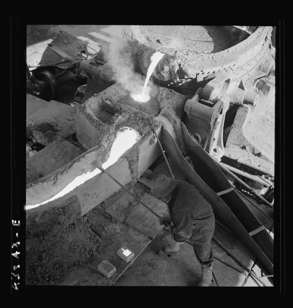 Columbia Steel Company at Ironton, Utah. Pouring a heat of iron