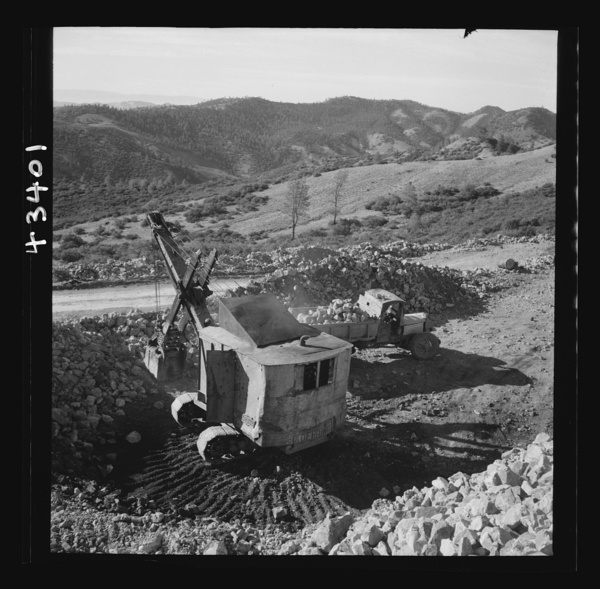 New Idria, California. A power shovel loading mercury ore, called cinnabar, at an open-cut mine of the New Idria Quicksilver Mining Company