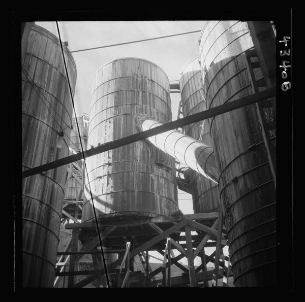 New Idria, California. Tanks at the mercury extraction plant of the Quicksilver Mining Company where mercury is obtained from cinnabar, an ore mined at a number of workings near the plant