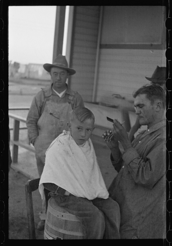 Untitled photo, possibly related to: Community barber shop in Kern County migrant camp, California