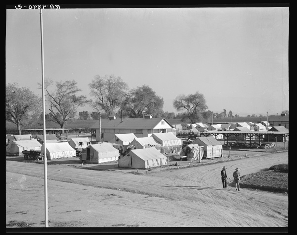 View of Kern migrant camp showing one of three sanitary units. California