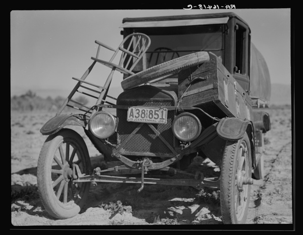 Car of drought refugee on edge of carrot field in the Coachella Valley. California