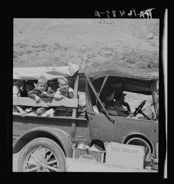 Family of drought refugees on U.S. 99 near Bakersfield, California