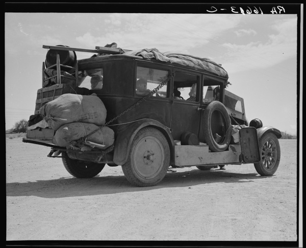 Family of nine from Fort Smith, Arkansas, trying to repair their car on road between Phoenix and Yuma, Arizona. On their way to try to find work in the California harvests