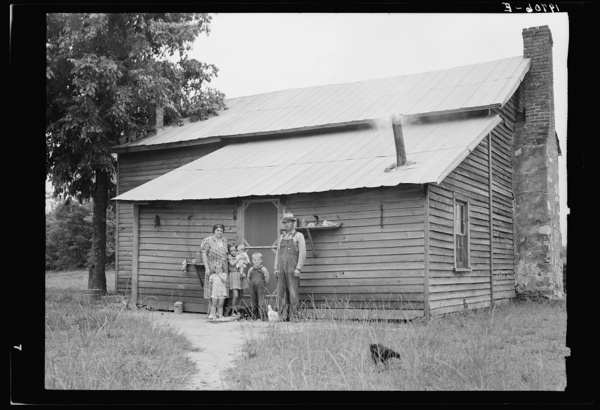 Tobacco sharecroppers and family at back of their house. Person County, North Carolina