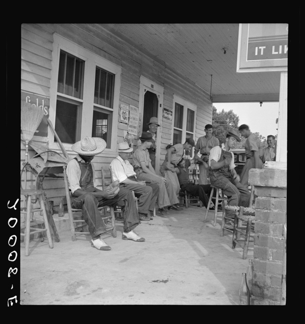 Rural filling station becomes community center and general grounds for loafing. The men in baseball suits are on a local team which will play a game nearby. The team is called the Cedargrove Team. Fourth of July, Near Chapel Hill, North Carolina