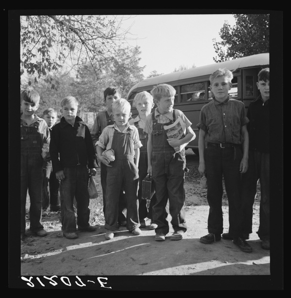 The children from Dead Ox Flat get off bus at school yard. Ontario, Malheur County, Oregon. General caption number 67-1V
