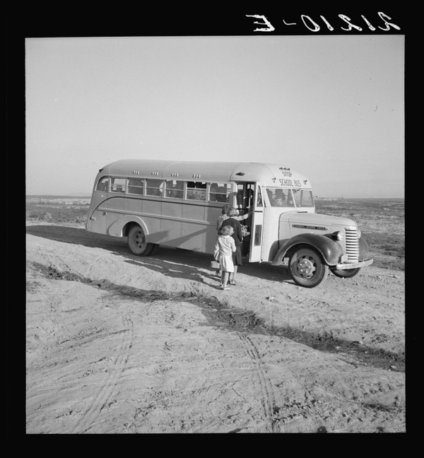 Dead Ox Flat. Children get into school bus on a fall morning. Malheur County, Oregon. General caption number 67-1V