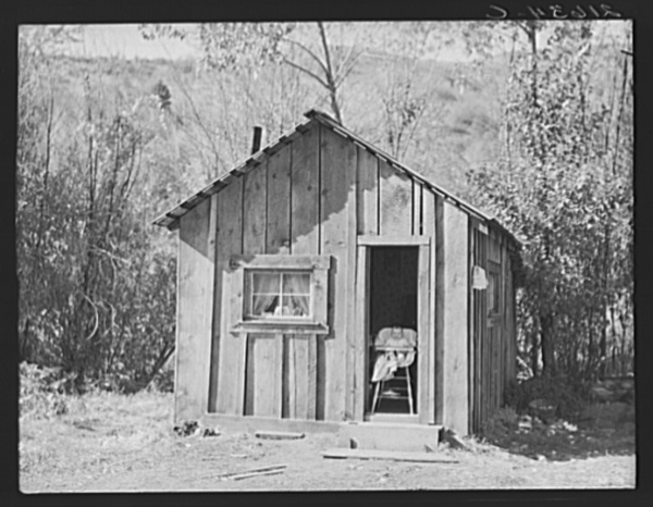 "Home of one member of Ola self-help sawmill co-op, Gem County, Idaho. ""She likes to sit in the door and watch the geese."" General caption 48"