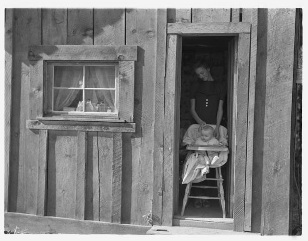 Wife and baby of president of Ola self-help sawmill co-op in doorway of their home. Gem County, Idaho. General caption 48