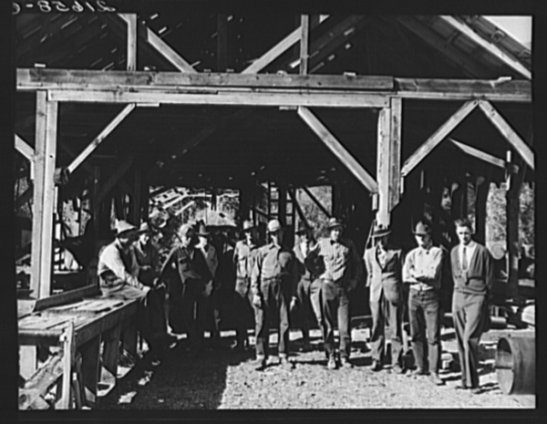 Men working in mill. Ola self-help sawmill co-op. Gem County, Idaho. Man in rear center in black hat is FSA (Farm Security Administration) county supervisor. General caption 48