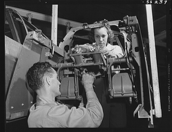Rudder controls are assembled by men and women on North American Aviation's P-51 fighter final assembly line