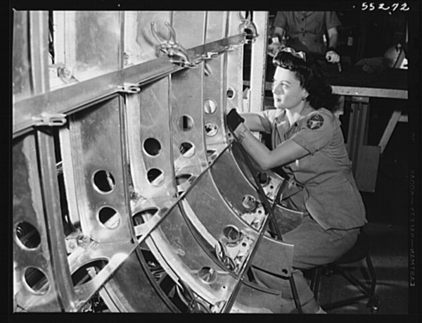 One of North American Aviation's many women employees assembles a B-25 tank structure
