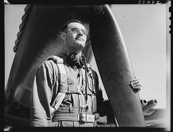 Captain C.R. Douglass, Assistant Army Air Forces Representative at North American Aviation, looks aloft before taking another P-51 fighter into the air for a routine test flight