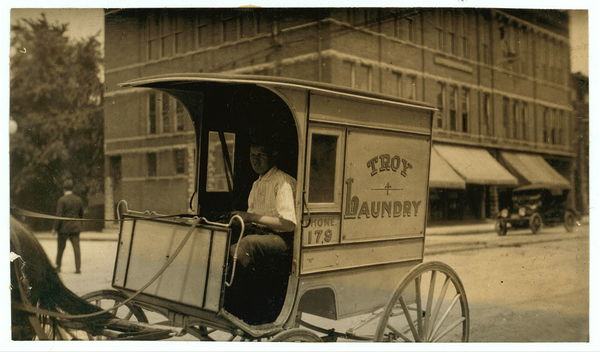 13-year-old laundry boy driving wagon. See report.  Location: Bowling Green, Kentucky																  	/ 					  						  	L.W. Hine.