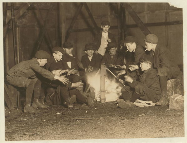 Jefferson St. Gang of newsboys at 10:00 P.M. over campfire in corner lot behind bill-board. Jefferson St. near Olive. May 7, 1910. Witness E.N. Clopper,.  Location: St. Louis, Missouri.