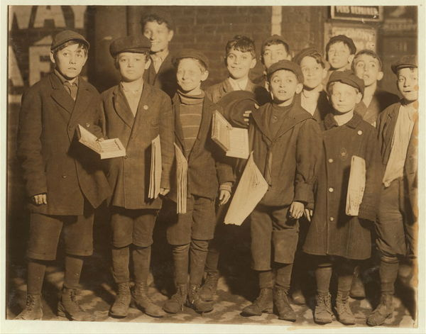 9:00 P.M. Group of young newsboys and venders selling late at night. Some of them were selling in saloons at that time. May 7, 1910. Witness E.N. Clopper.  Location: St. Louis, Missouri.