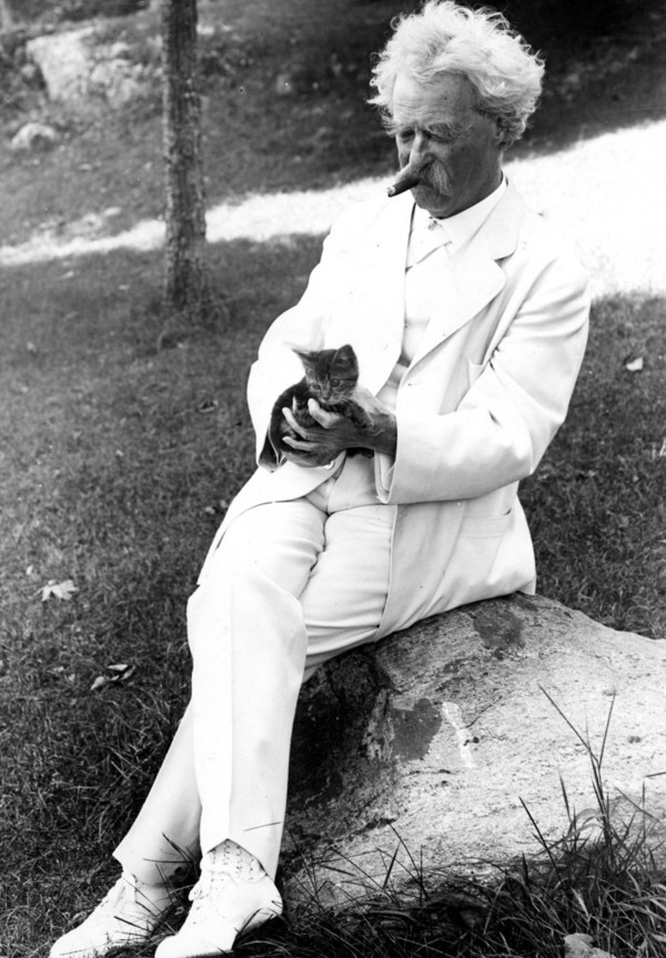 Samuel L. Clemens with kitten. Tuxedo Park, New York, 1907.