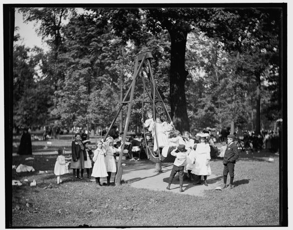 Children swinging in a playground or park