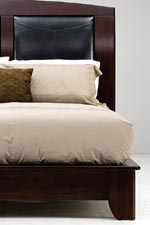 Sleigh beds have leather upholstered headboards
