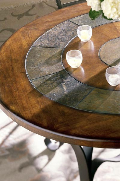 tabletops feature concentric rings of solid oak and quarried stone