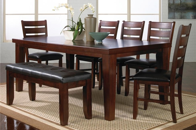 We carry a huge selection of dining tables, chairs, barstools, servers, china cabinets, and complete sets.