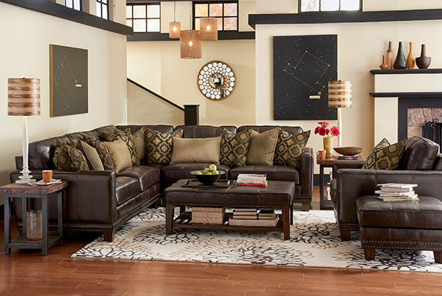 Taking inspiration from industrial, sophisticated transitional, and steampunk styles, the Port Royal leather collection feature an intricate nailhead stud border that instantly catches the eyes. Tapered wood legs and complementing fabric toss pillows complete the piece with charm and flair.