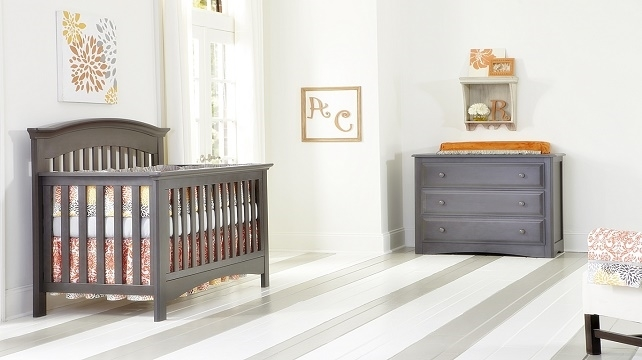 Dark brown baby room with crib