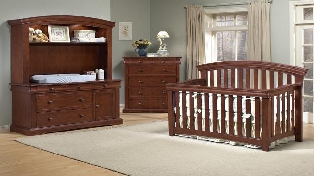 Brown crib and baby room