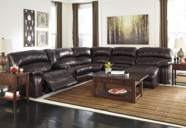 Damacio sectional with console and right side reclining chaise