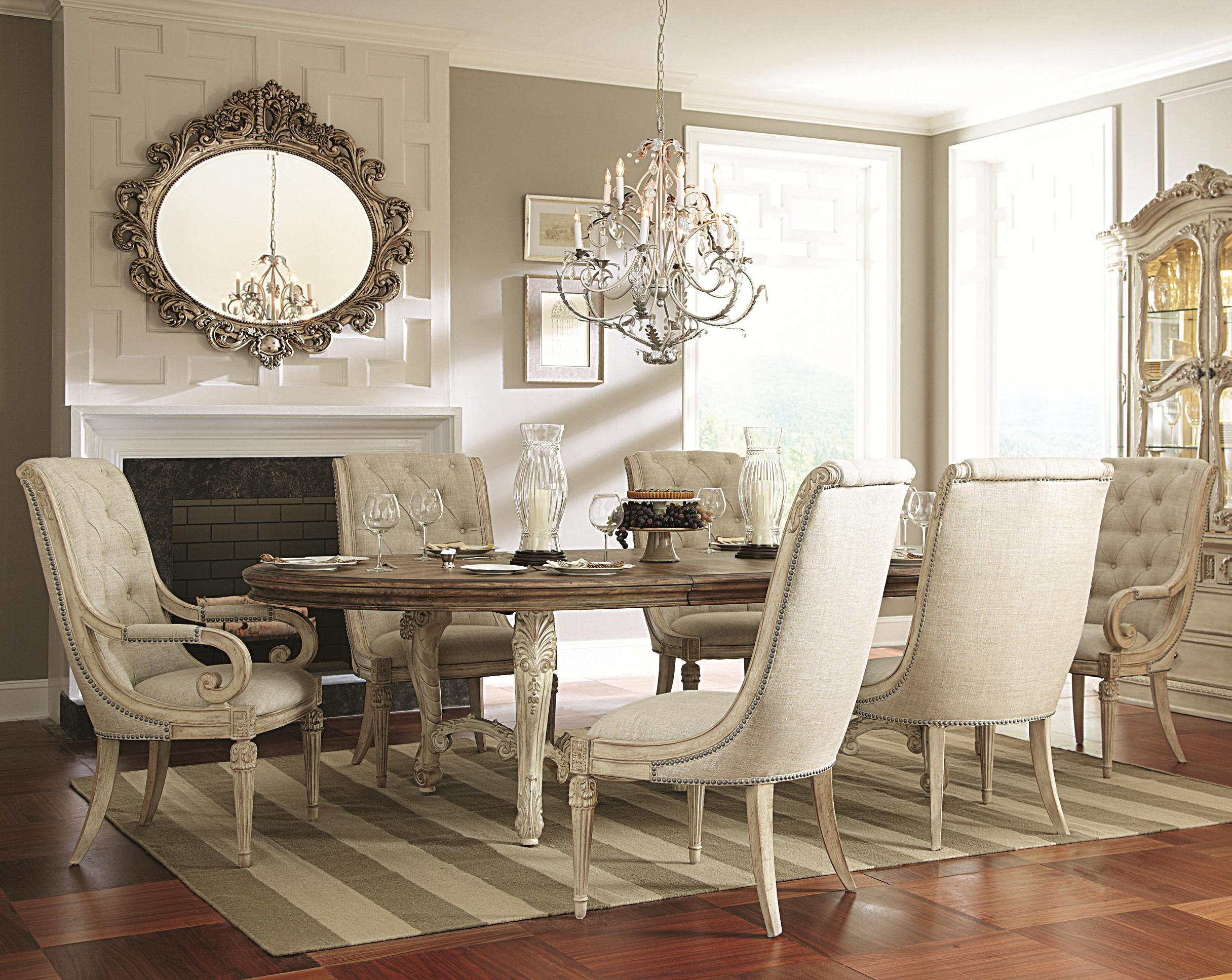 7 Piece Oval Dining Table With Upholstered Arm Side Chairs
