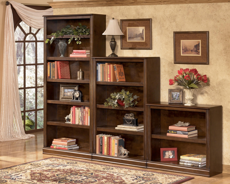 Книжные шкафы и библиотеки для дома, разновидности с размера.
