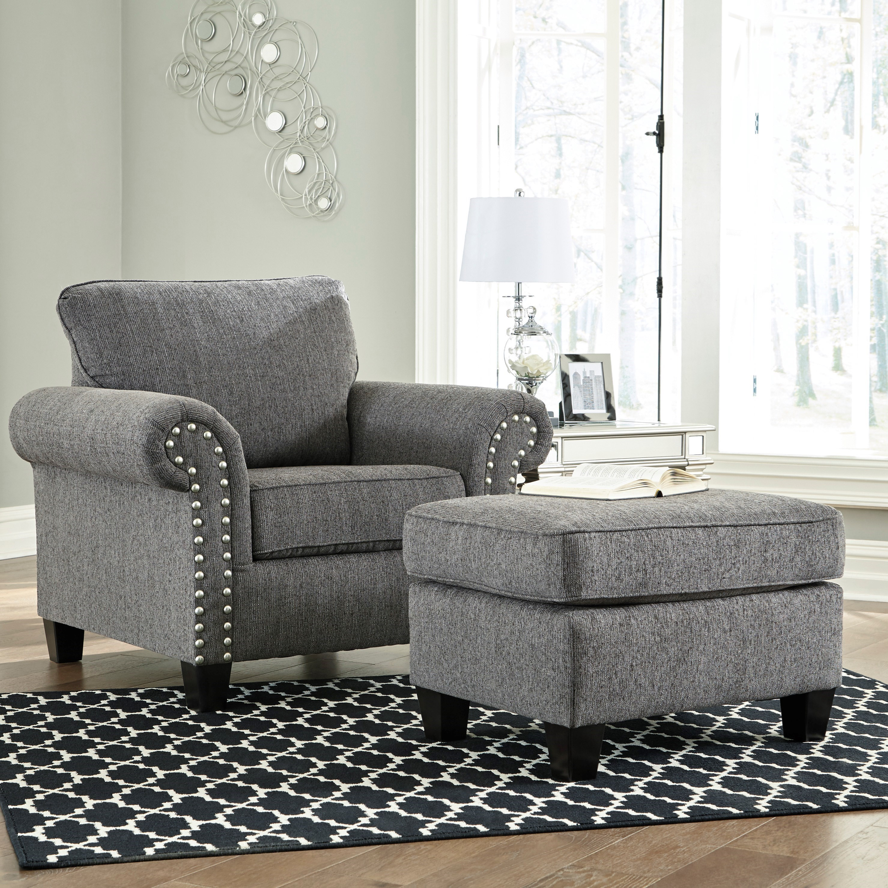 Contemporary Chair and Ottoman with Nail Head Trim
