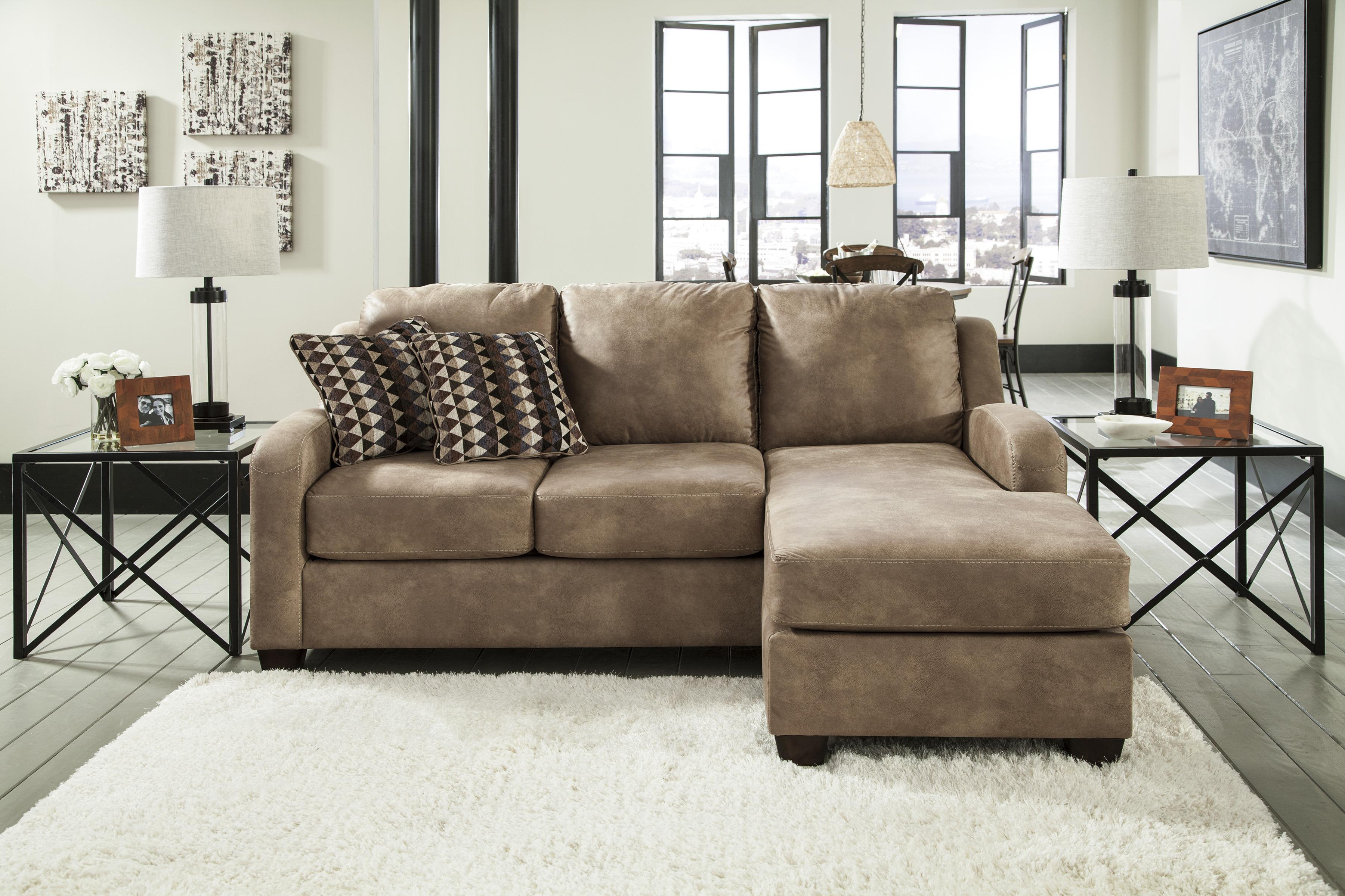 contemporary faux leather sofa chaise by benchcraft wolf furniture rh wolffurniture com benchcraft leather chair benchcraft leather chair