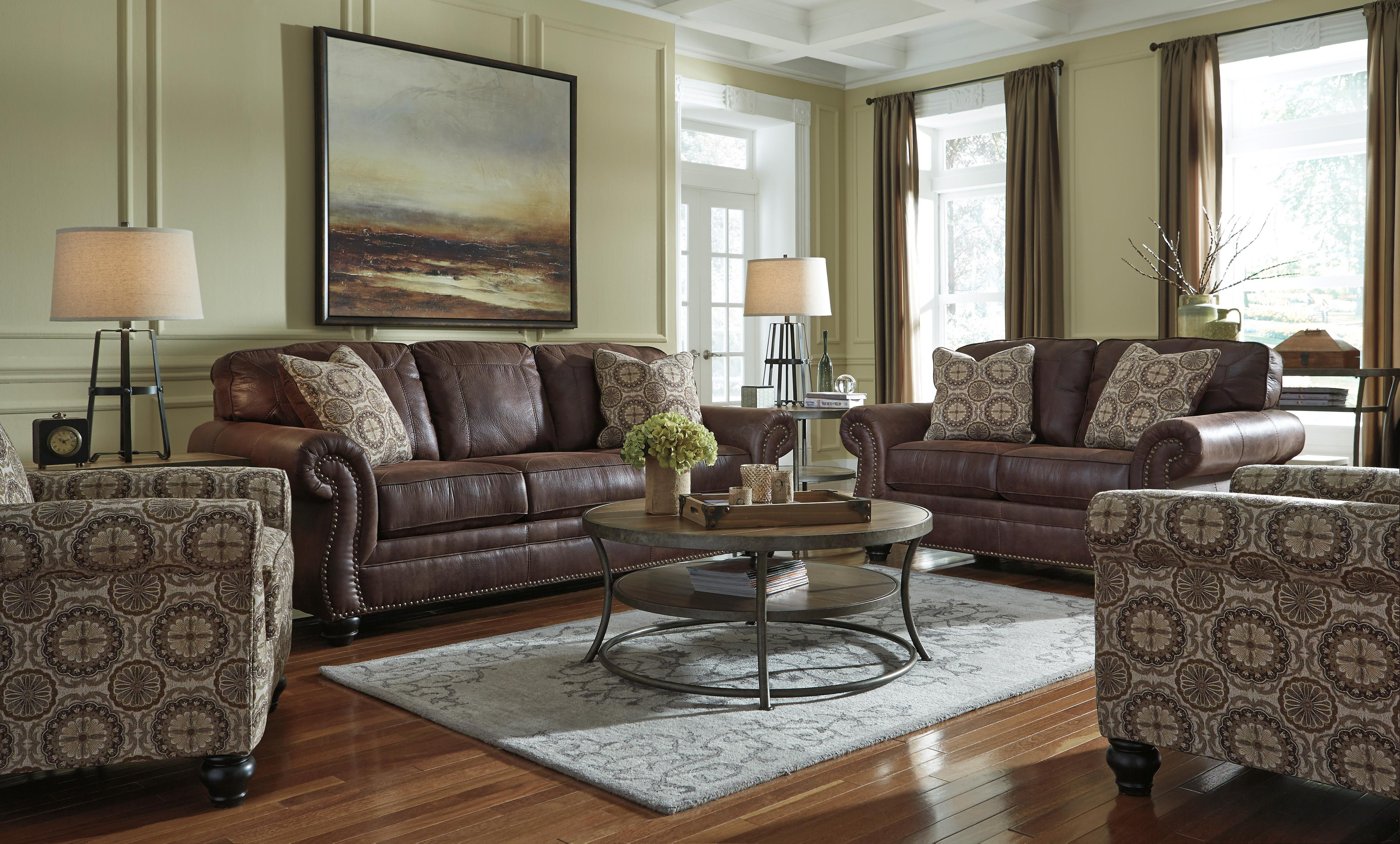 Faux Leather Loveseat With Rolled Arms Nailhead Trim By Benchcraft