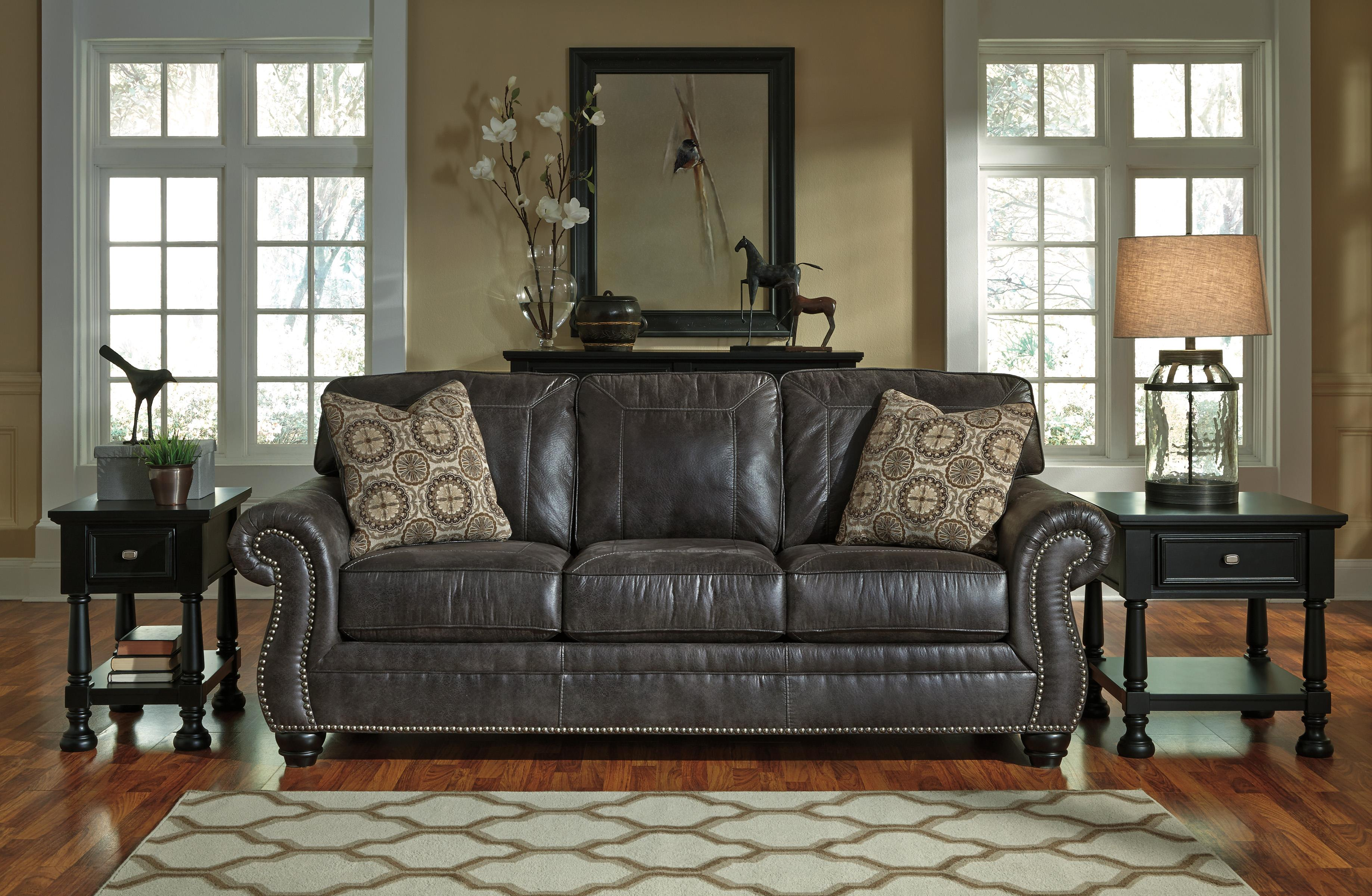 faux leather sofa with rolled arms and nailhead trim by benchcraft rh wolffurniture com benchcraft leather chair benchcraft leather sectional sofa