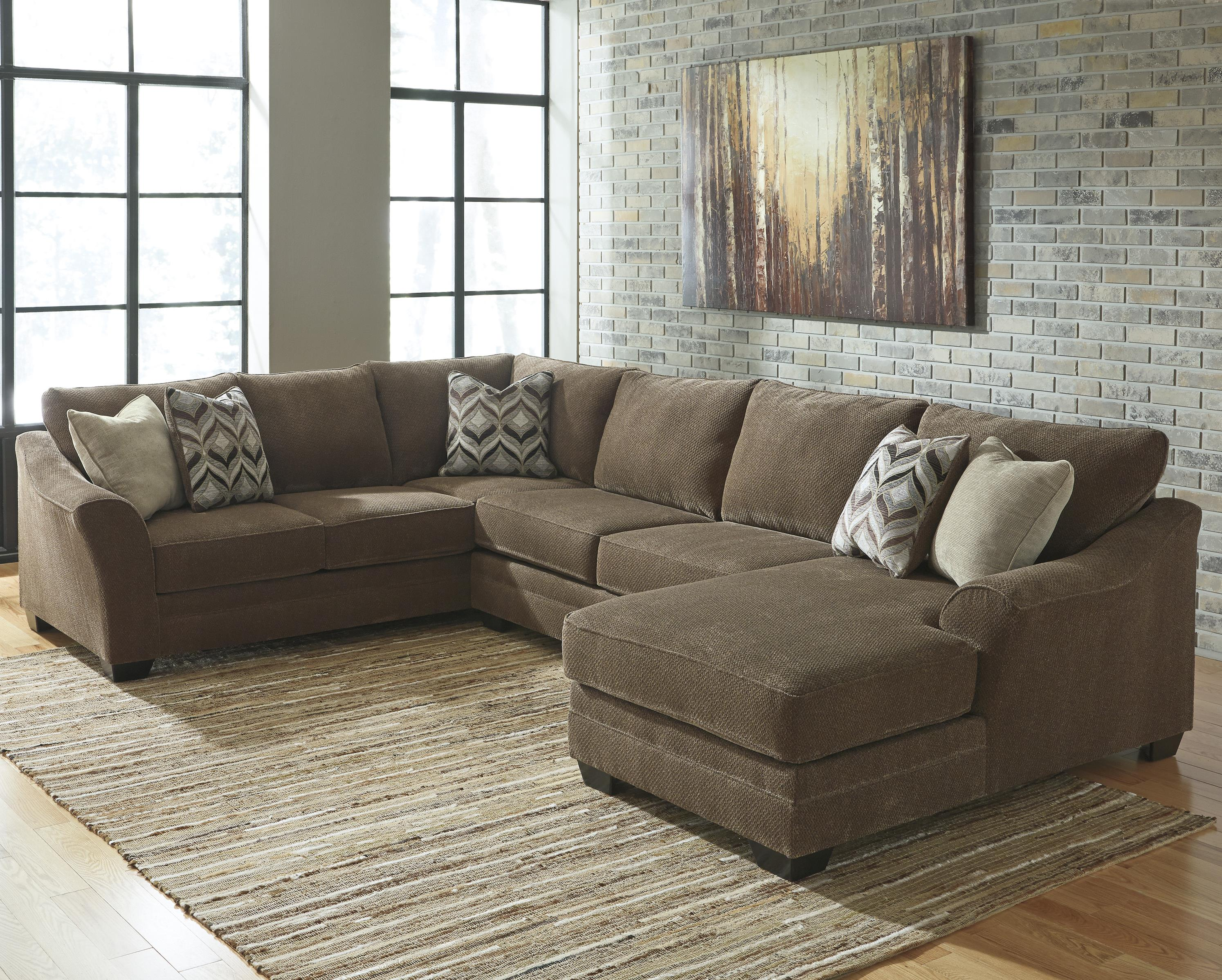 benchcraft item sectional nuvella kirwin in with number chaise performance right products