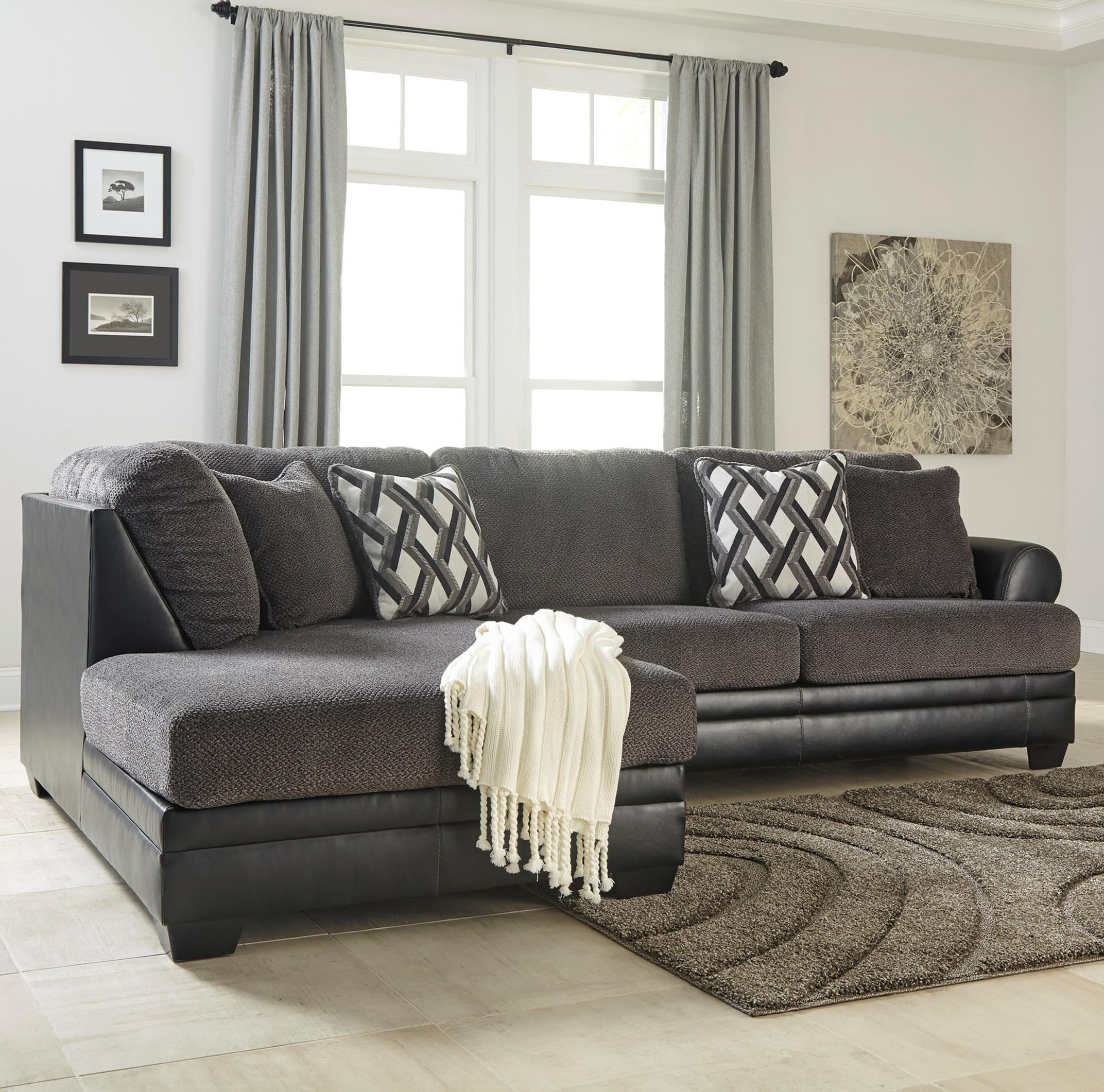 2 piece fabric faux leather sectional with left chaise by benchcraft wolf and gardiner wolf furniture