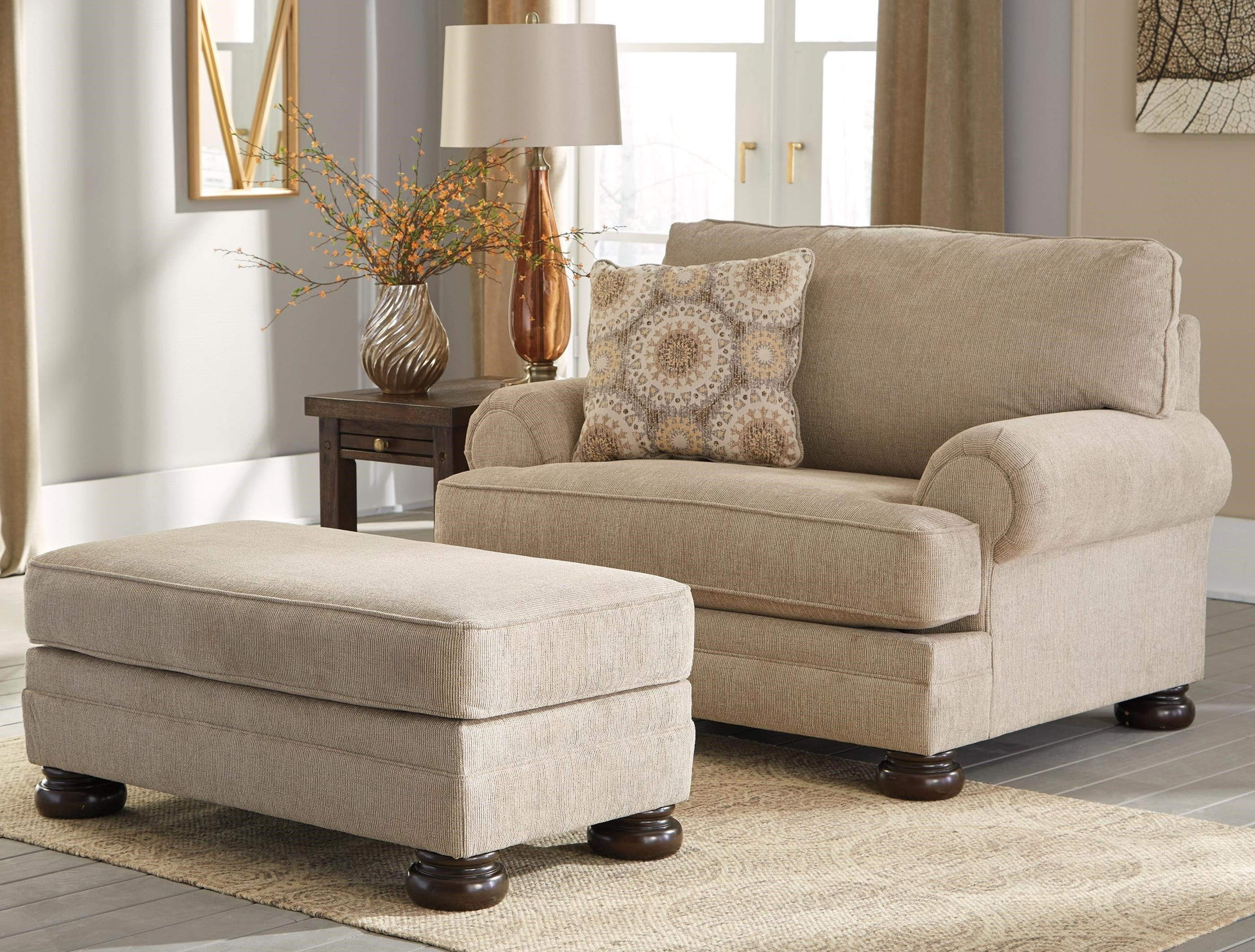 furnishings half store sparks homestore a with m axiom signature design browsecatalog and by products walnut home ottoman upholstered ashley chair direct