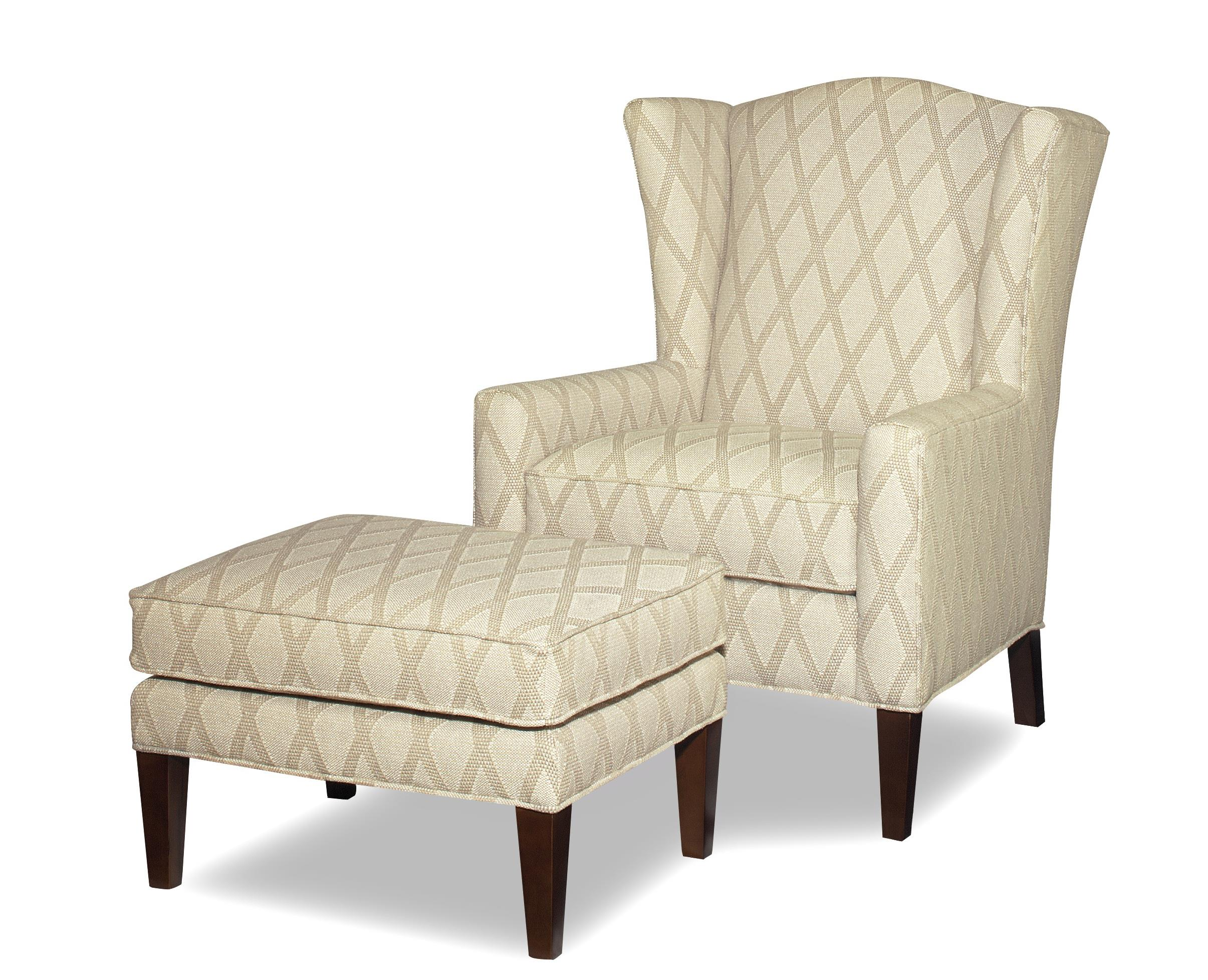 Wing Chair And Ottoman With Wide Flared Wings