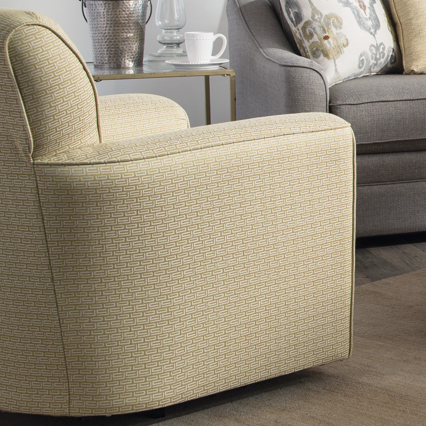 Contemporary Upholstered Swivel Chair with Flared Arms and Welt